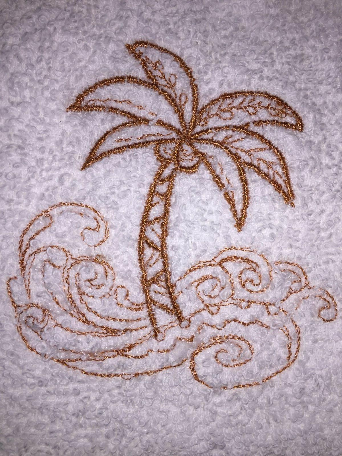 embroidered bathroom hand towel rust colored palm